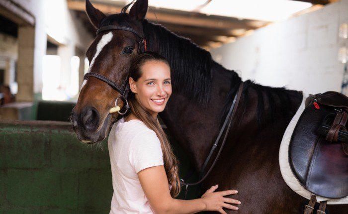 A female veteran in horse therapy